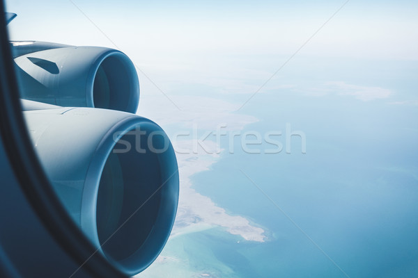 Airliner jet engines and coastal landscape Stock photo © dutourdumonde