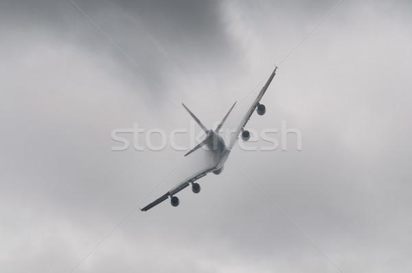 Vliegtuig vliegen slechte weer hemel vliegtuig wolk Stockfoto © dutourdumonde