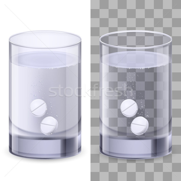 Stock photo: Glass of water and pills