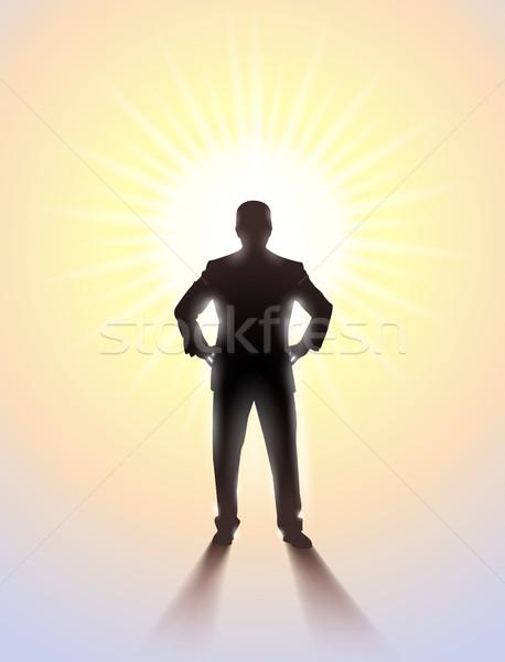 Silhouette of man standing in sunlight. Stock photo © dvarg