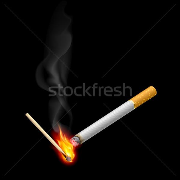 Cigarrette with burning match Stock photo © dvarg