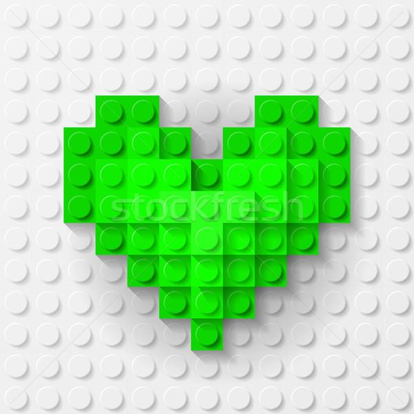 Green heart made of construction kit Stock photo © dvarg