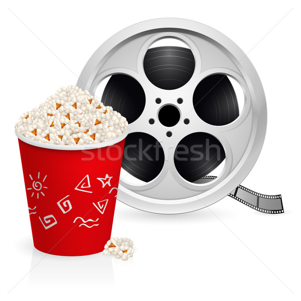 Stock photo: The film reel and popcorn