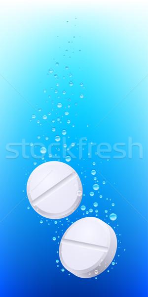 Pills in water Stock photo © dvarg