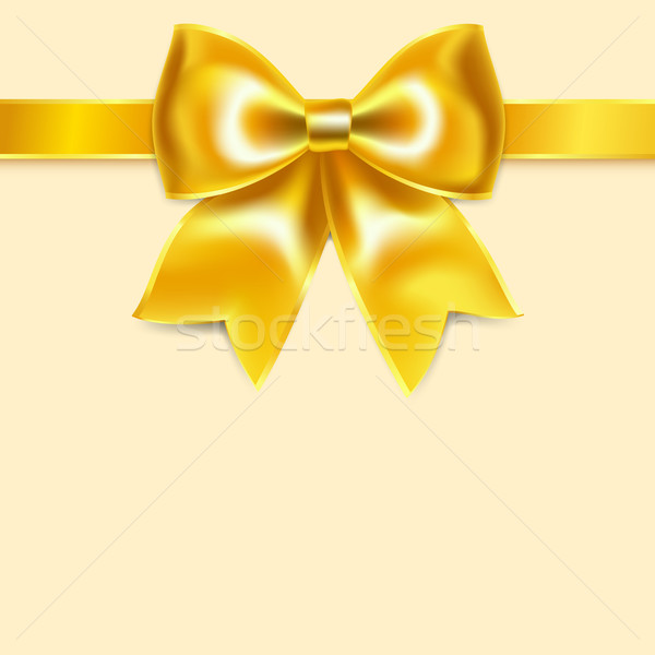 Yellow bow of silk ribbon, isolated on yellowish background Stock photo © Ecelop