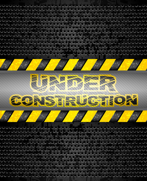 Under construction, black metallic background Stock photo © Ecelop