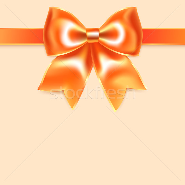 Orange bow of silk ribbon, isolated on peach background Stock photo © Ecelop
