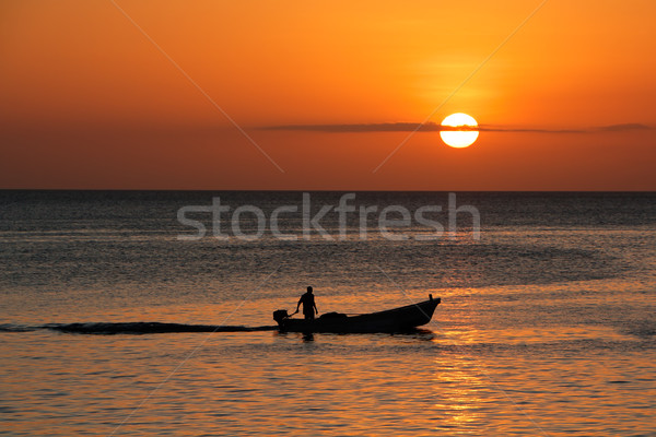 Boat silhouetted against sunset Stock photo © EcoPic