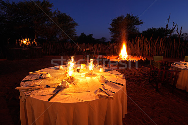 Nighttime campfire and table Stock photo © EcoPic