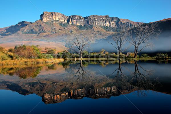 Kumtaşı dağlar yansıma simetrik su kraliyet Stok fotoğraf © EcoPic