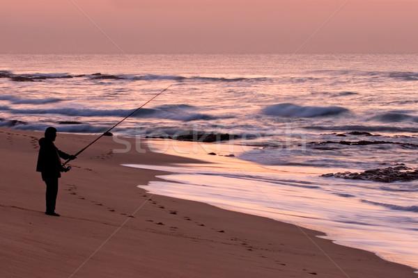 Fisherman at sunrise Stock photo © EcoPic
