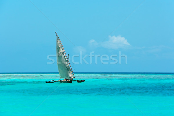 Wooden sailboat on water Stock photo © EcoPic