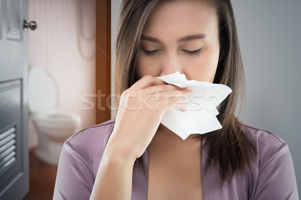 Stock photo: The woman in nightware smell bad of dirty bahtroom.