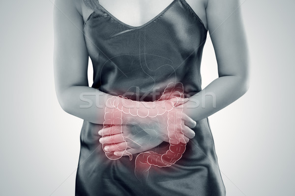 Ulcerative Colitis, The photo of large intestine is on the woman Stock photo © eddows_arunothai