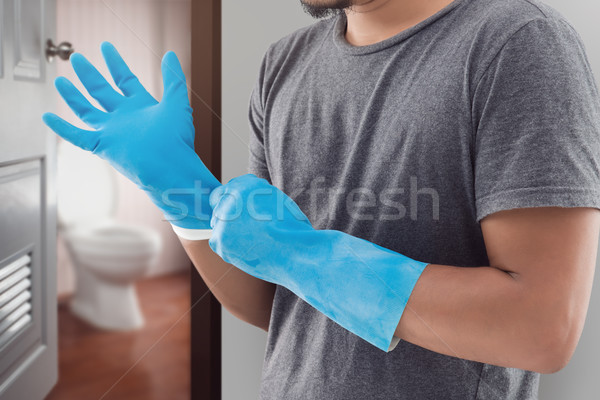 Asian man is preparing all equipments for cleaning toilet. Stock photo © eddows_arunothai