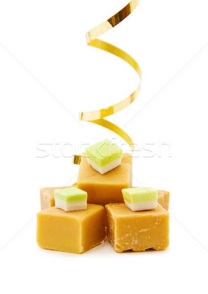 Caramel fudge with golden ribbon Stock photo © Eireann