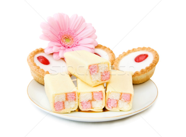 Minitorták édesség desszert tányér sült izolált Stock fotó © Eireann