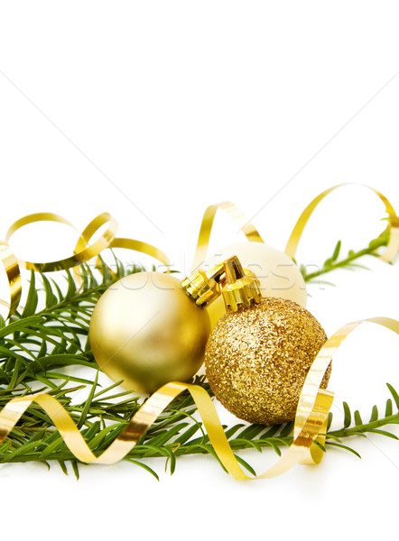 Christmas pine tree branch and golden baubles Stock photo © Eireann