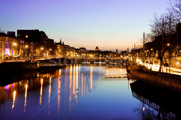 Dublin at sunset - view over Grattan bridge on Liffey river Stock photo © Eireann