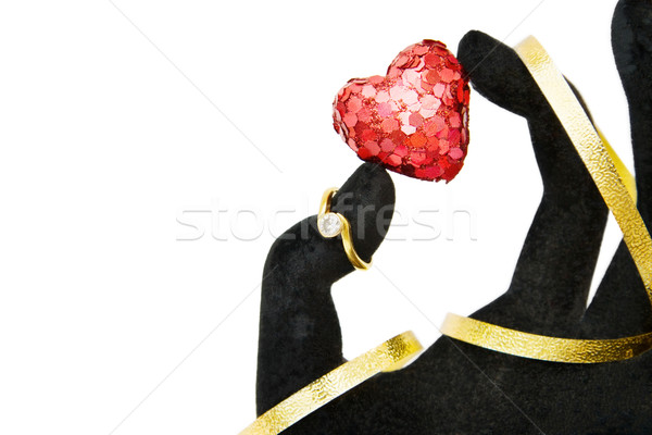 Marry Me! - hand giving diamond engagement ring and sparkling red heart as a symbol of love. Isolate Stock photo © Eireann