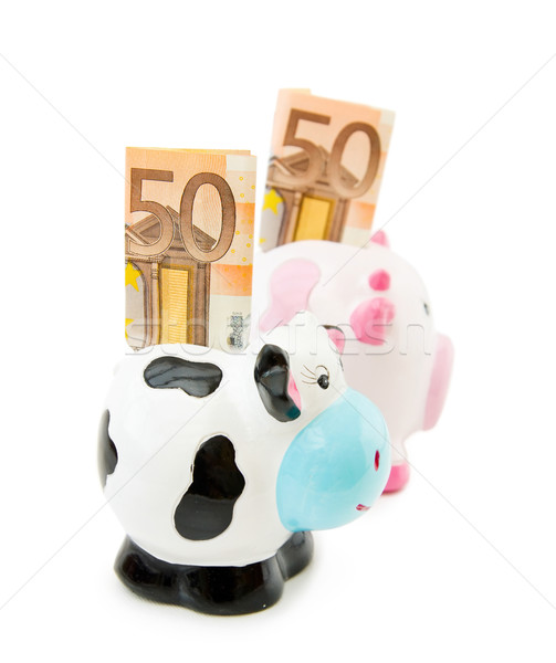 Piggy and Cowie money banks Stock photo © Eireann