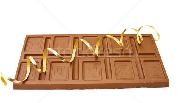 Chocolate fita grande comprimido isolado Foto stock © Eireann