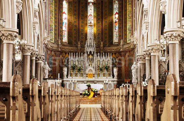 Prayer to God in front of a beautiful Christian altar Stock photo © Eireann