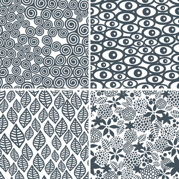 Four black and white seamless patterns. Stock photo © ekapanova