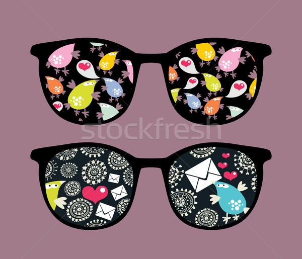 Retro eyeglasses with strange birds reflection. Stock photo © ekapanova