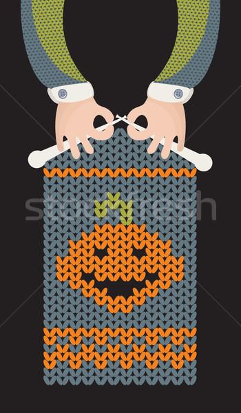 Man is knitting pumpkin. Stock photo © ekapanova