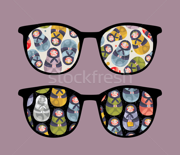 Retro sunglasses with dolls reflection in it. Stock photo © ekapanova