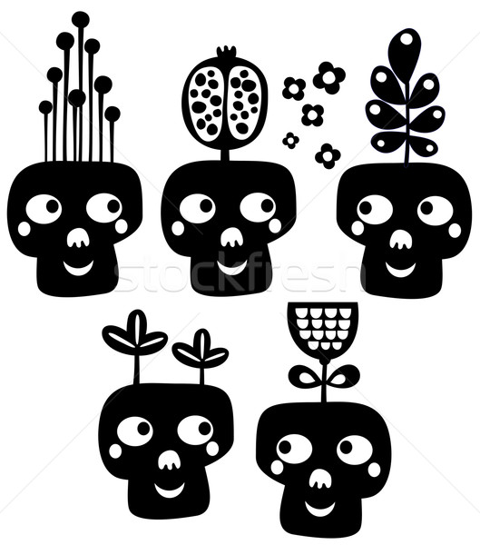 Funny skulls with flowers. Stock photo © ekapanova