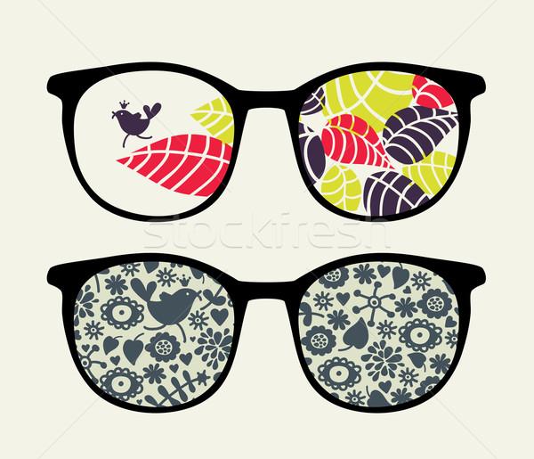 Retro sunglasses with small bird reflection. Stock photo © ekapanova