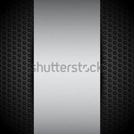 brushed metallic panel on black mesh Stock photo © elaine