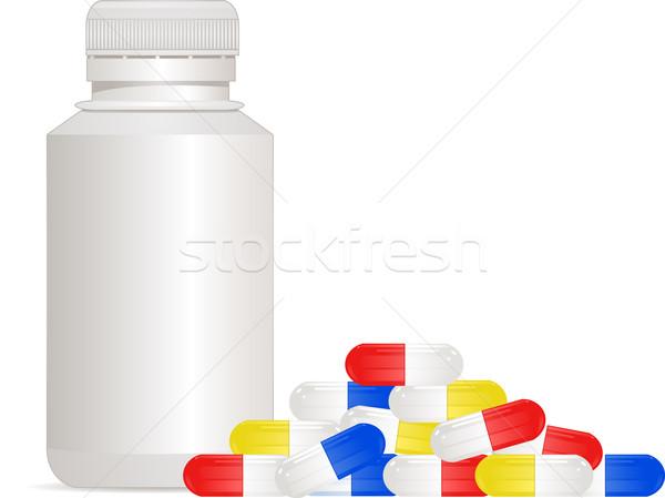 Medicine bottle and pills  Stock photo © elaine