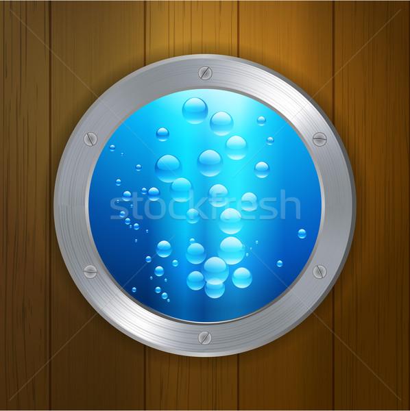 Porthole on wood under the sea Stock photo © elaine