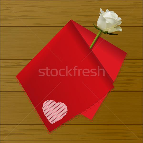 Teat towel folded on a rose on wood background Stock photo © elaine