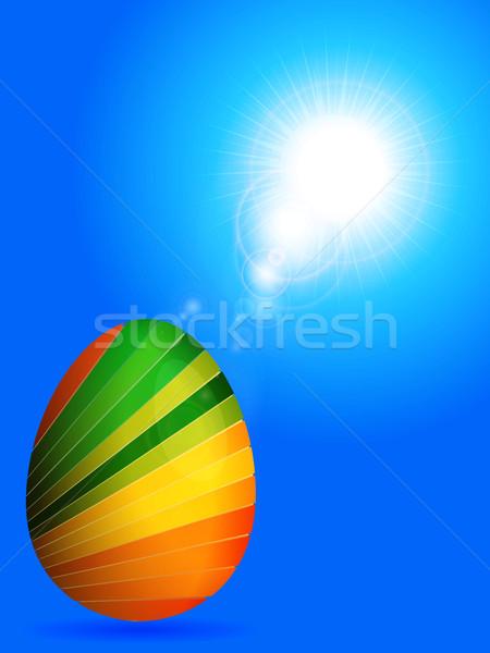 A rayas huevo de Pascua soleado cielo azul 3d azul Foto stock © elaine