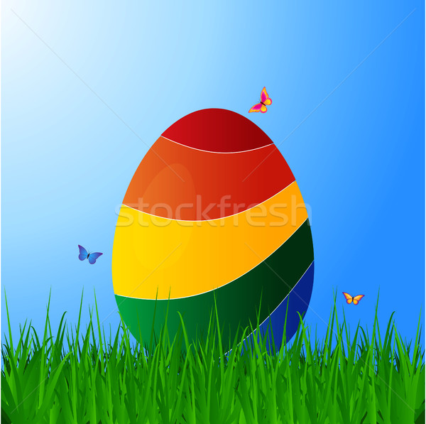 Curved striped Easter egg on grass over blue sky Stock photo © elaine