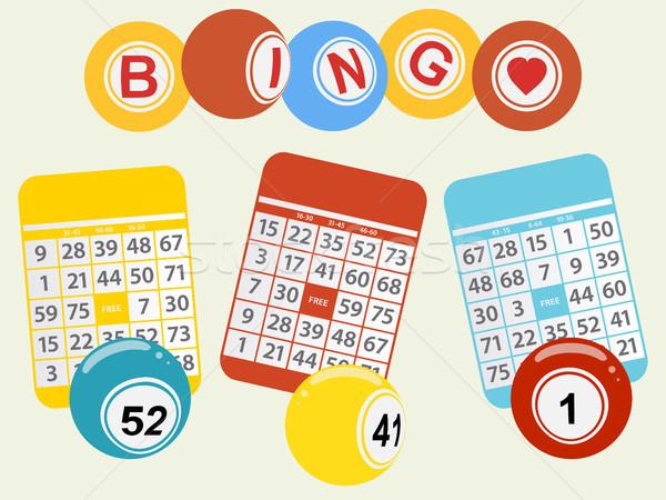 Three bingo balls and cards on light green background Stock photo © elaine