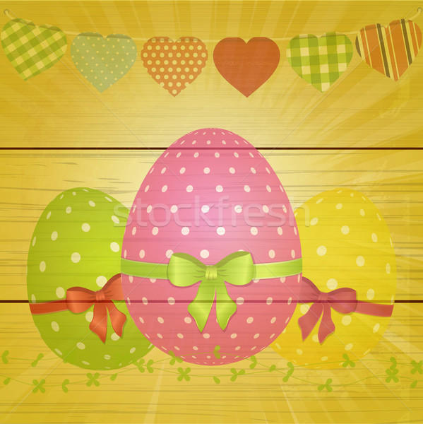Easter eggs and bunting on wooden background Stock photo © elaine