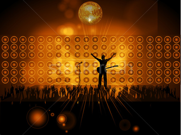 Rockstar with guitar and microphone on stage with wall speakers Stock photo © elaine