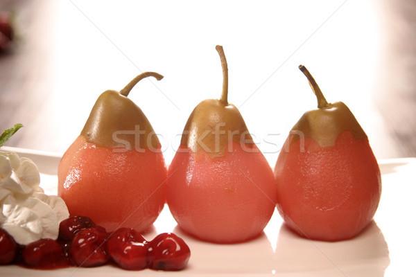 Peras cerejas creme três parcialmente lado Foto stock © eldadcarin