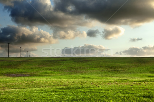 Stock photo: Grassy Hills under Dramatic Sky