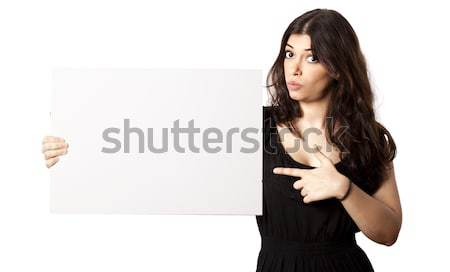 Isolated Surprised Woman Pointing at Sign Stock photo © eldadcarin