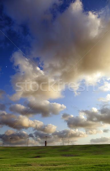 Herbeux collines dramatique ciel nombre rue Photo stock © eldadcarin