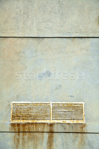 Textured Wall & Rusty Vent Shaft Cover Stock photo © eldadcarin