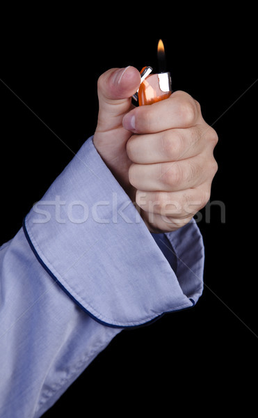 Isolated Hand in Robe Ignisting a Lighter Stock photo © eldadcarin