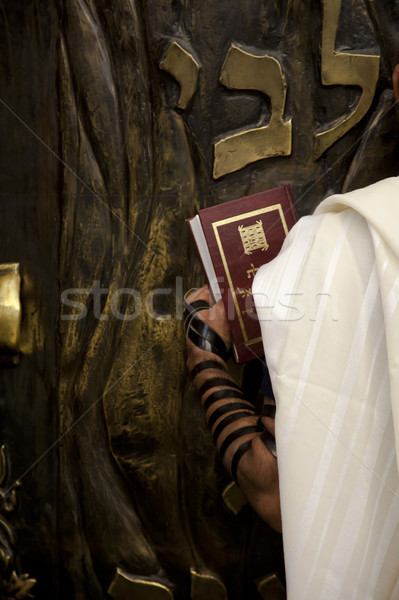 Praying infront of the Bible Cabinet Stock photo © eldadcarin
