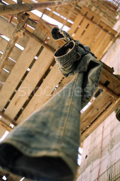 Abandonado jeans andaime madeira construção parede Foto stock © eldadcarin